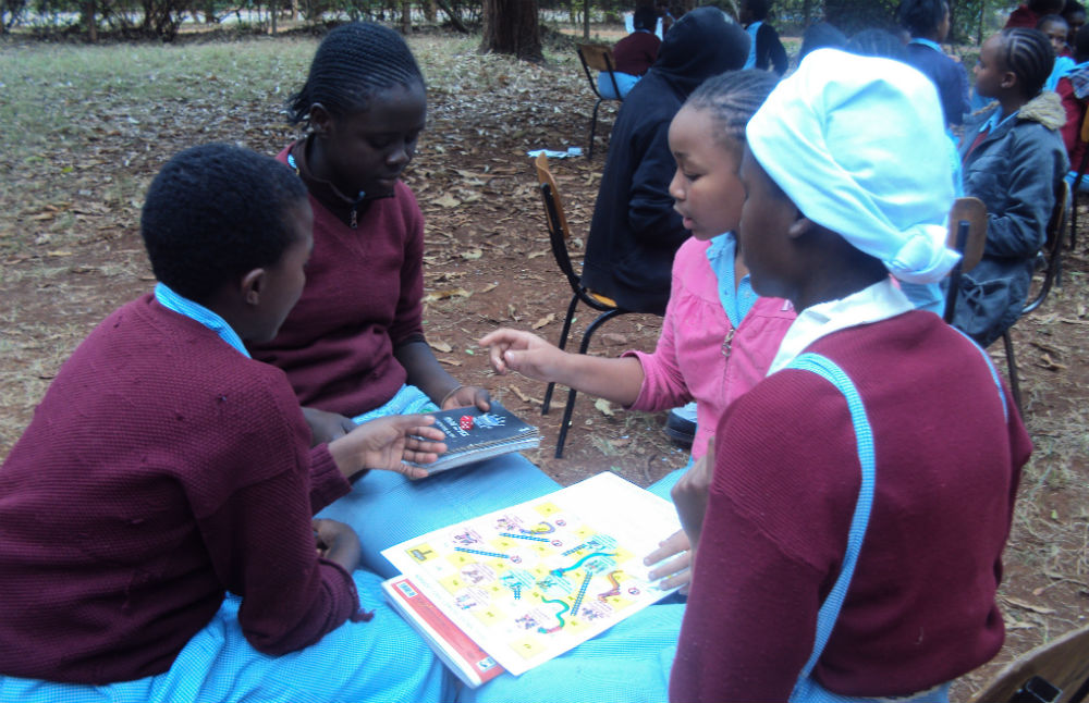 pupils at Kenyatta primary schools playing luddo game after having life skills sessions.